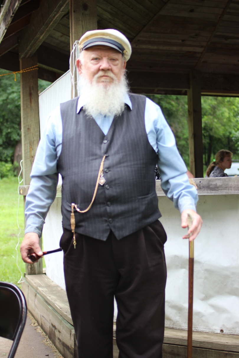 A sea-faring fellow named Gene, who we met at the Afton Strawberry Festival on Lake St. Croix.  This is his normal get-up, including the cane and the pipe.